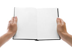 Hands holding an open book with blank pages Stock Images