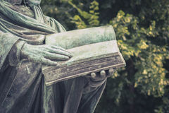 Hands holding open book  -  person reading book Stock Photography
