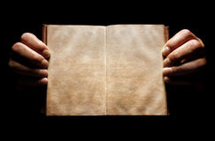 Hands holding an open empty book background Stock Photography