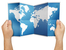 Hands Holding Open Folded World Map Isolated Stock Image