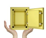 Hands holding open gold safe Stock Photography