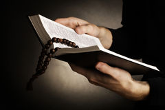 Hands holding open holy   bible Royalty Free Stock Photos
