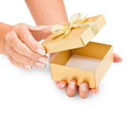 Hands holding an opened gift box Royalty Free Stock Photo