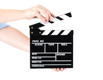 Hands holding out a clapper board. Isolated on white background Royalty Free Stock Photo