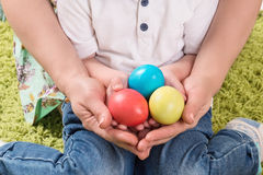 Hands holding painted easter egg Royalty Free Stock Image
