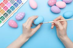 Hands holding a painted egg royalty free stock photo
