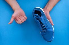 New sneakers in the hands. royalty free stock photos