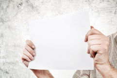 Hands holding paper Royalty Free Stock Image