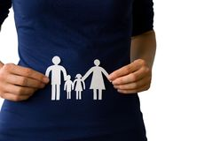 Hands holding a paper chain family Stock Photo