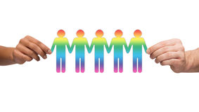 Hands holding paper chain gay people Stock Photo
