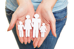 Hands holding paper family Stock Photography