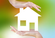 Hands holding a paper Home Stock Image