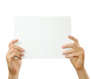 Hands holding paper Stock Image