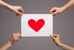 Hands holding paper with red heart Royalty Free Stock Photo
