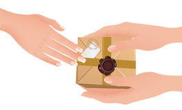 Hands holding parcel Royalty Free Stock Photo