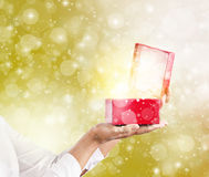 Hands holding and pening a red gift box. Stock Photography