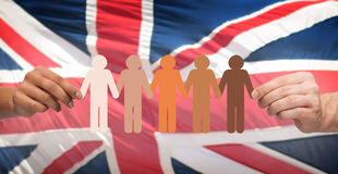 Hands holding people pictogram over english flag. Community, unity, population, race and humanity concept - multiracial couple hands holding chain of paper Stock Photos