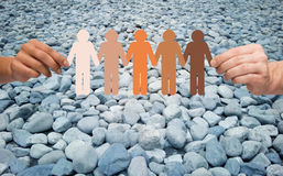 Hands holding people pictogram over stone desert Royalty Free Stock Photography