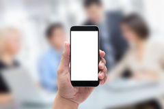 Hands holding the phone black blur business Stock Photos