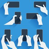 Hands holding a phone or other gadget. Flat template with long shadows. Royalty Free Stock Image