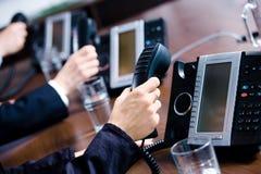 Hands holding phones Stock Photo