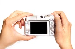 Hands holding photo camera Royalty Free Stock Images
