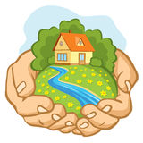 Hands holding a piece of land with a house. Royalty Free Stock Photos