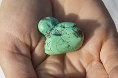 Hands holding piece of turquoise royalty free stock images