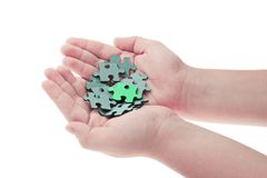 Hands holding pieces of jigsaw puzzle Royalty Free Stock Image