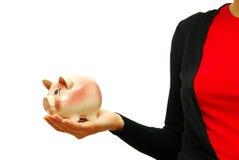 Hands holding piggy bank Stock Photo