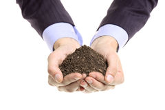 Hands holding a pile of soil Royalty Free Stock Photo