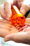 Hands holding pills Stock Photography