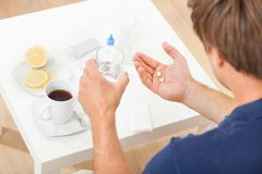Hands holding pills and water Royalty Free Stock Image