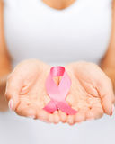 Hands holding pink breast cancer awareness ribbon Royalty Free Stock Photos