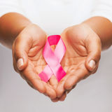 Hands holding pink breast cancer awareness ribbon Stock Image