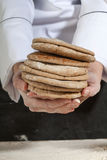 Hands holding pita bread Royalty Free Stock Image