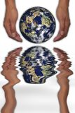 Hands holding planet. With water reflection over white background Royalty Free Stock Photos