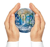 Hands holding the planet Earth isolated on a white background Stock Photos
