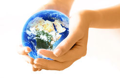 Hands Holding Planet. Girl hands holding the beautiful blue   planet Earth Royalty Free Stock Image