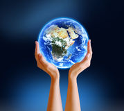 Hands Holding Planet. Girl hands holding the beautiful blue planet Earth Stock Image