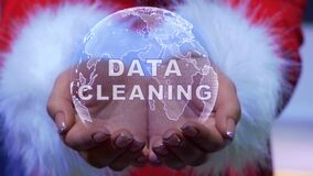 Hands holding planet with text Data cleaning