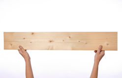 Hands holding plank Royalty Free Stock Photo