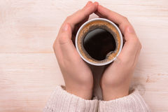 Hands holding plastic coffee cup. Top view of hands holding plastic coffee cup Stock Photo
