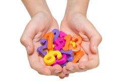 Hands holding plastic numbers. Royalty Free Stock Images