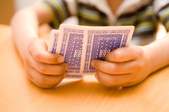 Hands Holding Playing Cards Royalty Free Stock Image