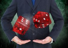Hands holding playing dice in air floating Stock Photo