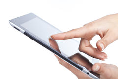 Hands holding and point to a tablet Stock Photography