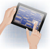 Hands holding and pointing on tablet Royalty Free Stock Images