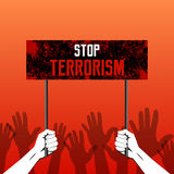 The hands holding. The poster with the text of Feet terrorism. The gestures of hands lifted up, showing a stop. A protest against terrorism, the extremist Royalty Free Stock Photos