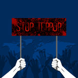 The hands holding. The poster with the text of Feet terrorism. The gestures of hands lifted up, showing a stop. A protest against terrorism, the extremist Royalty Free Stock Images